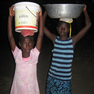 Picture of children carrying water.